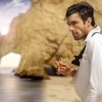 Formal man on beach